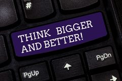 Conceptual hand writing showing Think Bigger And Better. Business photo text Have more great successful ideas. Development Keyboard key Intention to create royalty free stock images