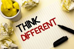 Conceptual hand writing showing Think Different. Business photo showcasing Rethink Change on vision Acquire New Ideas Innovate wri. Tten Notebook Paper the plain stock photography