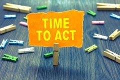 Conceptual hand writing showing Time To Act. Business photo text Do it now Response Immediately Something need to be done Clothesp. In holding orange paper note royalty free stock photos