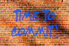 Conceptual hand writing showing Time To Commit. Business photo text Engagement or obligation that restricts freedom of. Action Brick Wall art like Graffiti stock images