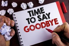 Conceptual hand writing showing Time To Say Goodbye. Business photo text Separation Moment Leaving Breakup Farewell Wishes Ending. Written by Man Notepad wooden Royalty Free Stock Images