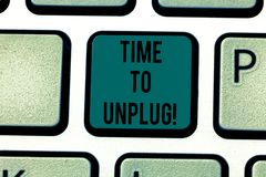 Conceptual hand writing showing Time To Unplug. Business photo text Relaxing giving up work disconnecting from everything Keyboard stock photography