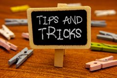 Conceptual hand writing showing Tips And Tricks. Business photo showcasing Suggestions to Make things easier Helpful Advices Solut. Ions Blackboard chalk letters royalty free stock images