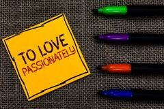 Conceptual hand writing showing To Love Passionately. Business photo text Strong feeling for someone or something else Affection W. Ritten on black lined yellow royalty free stock photography