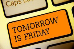 Conceptual hand writing showing Tomorrow Is Friday. Business photo text Weekend Happy holiday taking rest Vacation New week Button. Alphabets script keyboard royalty free stock photos