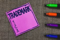 Conceptual hand writing showing Trademark. Business photo showcasing Legally registered Copyright Intellectual Property. Protection Purple Paper Important royalty free stock photography