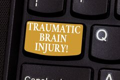 Conceptual hand writing showing Traumatic Brain Injury. Business photo showcasing Insult to the brain from an external. Mechanical force Keyboard key Intention royalty free stock images