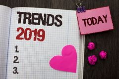 Conceptual hand writing showing Trends 2019. Business photo showcasing Current Movement Latest Branding New Concept Prediction wri. Tten Notebook Book wooden stock images