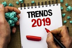 Conceptual hand writing showing Trends 2019. Business photo text Current Movement Latest Branding New Concept Prediction written b. Y Man Holding Marker Notebook stock image