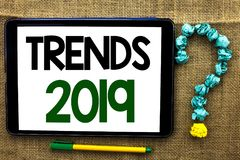 Conceptual hand writing showing Trends 2019. Business photo text Current Movement Latest Branding New Concept Prediction written o. Conceptual hand writing royalty free stock photos