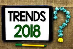 Conceptual hand writing showing Trends 2018. Business photo text Current Movement Latest Modern Branding New Concept Prediction wr. Itten Tablet the jute royalty free stock photo