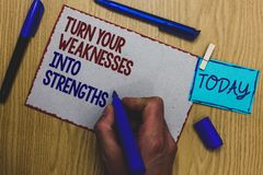 Conceptual hand writing showing Turn Your Weaknesses Into Strengths. Business photo text work on your defects to get raid of them. Man holding marker paper stock image