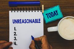 Conceptual hand writing showing Unreasonable. Business photo text Beyond the limits of acceptability or fairness Inappropriate Man. Holding marker notebook stock photography