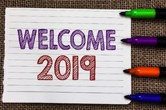 Conceptual hand writing showing Welcome 2019. Business photo showcasing New Year Celebration Motivation to Start Cheers Congratula. Tions Notebook Paper stock photos