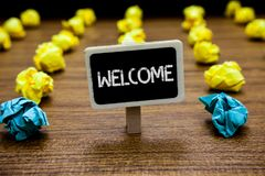 Conceptual hand writing showing Welcome. Business photo showcasing Warm salutation acknowledgement for someone amiable loved thank. Ed Creative idea paper object royalty free stock photo