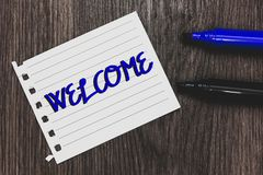 Conceptual hand writing showing Welcome. Business photo text Warm salutation acknowledgement for someone amiable loved thanked Mar. Ker pens white paper black stock photos