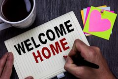 Conceptual hand writing showing Welcome Home. Business photo text Expression Greetings New Owners Domicile Doormat Entry Man holdi royalty free stock photos