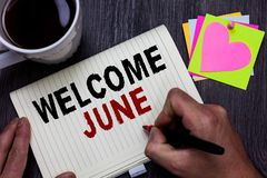 Conceptual hand writing showing Welcome June. Business photo text Calendar Sixth Month Second Quarter Thirty days Greetings Man ho. Lding marker giving ideas royalty free stock image
