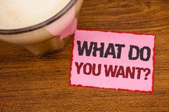 Conceptual hand writing showing What Do You Want Question. Business photo text Aspiration Contemplation Need Contemplate Aspire Wo. Oden desktop red lined pink stock photo