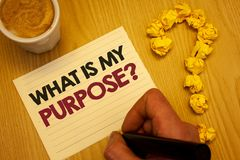 Conceptual hand writing showing What Is My Purpose Question. Business photo showcasing Direction Importance Discernment Reflection. Wooden desktop hand hold stock photos
