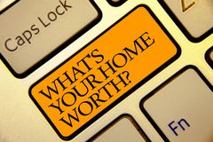 Conceptual hand writing showing What s is Your Home Worth question. Business photo text Value of a house Property Cost Price Rate. Golden grey computer keyboard stock photos