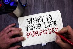 Conceptual hand writing showing What Is Your Life Purpose Question. Business photo showcasing Personal Determination Aims Achieve. Goal Man hold holding red stock images