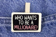 Conceptual hand writing showing who Wants To Be A Millionaire Question. Business photo text Earn more money applying knowledge wri. Tten Wood Piece the Jeans Stock Image