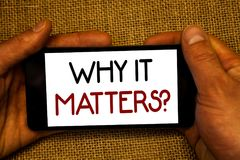 Conceptual hand writing showing Why It Matters Question. Business photo text Important Reasons to do something Motivation Goal Man. Holding cell phone screen Royalty Free Stock Photo