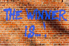 Conceptual hand writing showing The Winner Is . Business photo text Announcing who won a contest Victory on a royalty free stock images