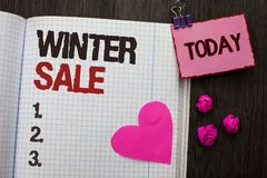 Conceptual hand writing showing Winter Sale. Business photo showcasing Promotion Offer Shop Discount Season Offers Auction Deal Ob. Jective written Notebook Book Royalty Free Stock Images
