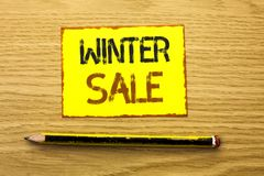 Conceptual hand writing showing Winter Sale. Business photo showcasing Promotion Offer Shop Discount Season Offers Auction Deal Ob. Jective written Yellow Sticky Stock Photos