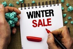 Conceptual hand writing showing Winter Sale. Business photo text Promotion Offer Shop Discount Season Offers Auction Deal Objectiv. E written by Man Holding Stock Photo