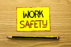 Conceptual hand writing showing Work Safety. Business photo showcasing Caution Security Regulations Protection Assurance Safeness. Written Yellow Sticky Note Stock Images