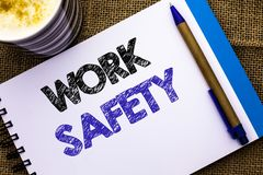Conceptual hand writing showing Work Safety. Business photo showcasing Caution Security Regulations Protection Assurance Safeness. Written Notebook Book the Stock Photography