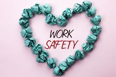 Conceptual hand writing showing Work Safety. Business photo text Caution Security Regulations Protection Assurance Safeness writte. N Plain background within Stock Photography