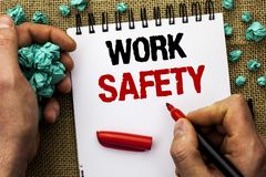 Conceptual hand writing showing Work Safety. Business photo text Caution Security Regulations Protection Assurance Safeness writte. N by Man Holding Marker Stock Image
