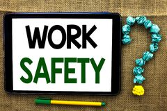 Conceptual hand writing showing Work Safety. Business photo text Caution Security Regulations Protection Assurance Safeness writte. N Tablet the jute background Royalty Free Stock Image