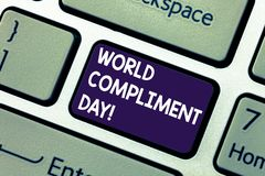 Conceptual hand writing showing World Compliment Day. Business photo showcasing basic huanalysis need for recognition. And appreciation day Keyboard key stock photos