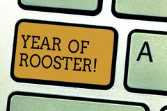 Conceptual hand writing showing Year Of Rooster. Business photo text Chinese horoscope zodiac sign China traditional. Celebration Keyboard key Intention to stock photos