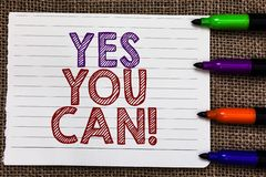 Conceptual hand writing showing Yes You Can. Business photo showcasing Positivity Encouragement Persuade Dare Confidence Uphold No. Tebook Paper Important royalty free stock image