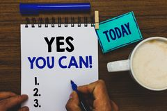 Conceptual hand writing showing Yes You Can. Business photo text Positivity Encouragement Persuade Dare Confidence. Uphold Man holding marker notebook clothepin royalty free stock photos