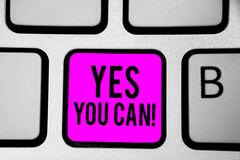 Conceptual hand writing showing Yes You Can. Business photo text Positivity Encouragement Persuade Dare Confidence Uphold Keyboard. Purple key Intention create stock images
