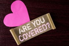 Conceptual hand writing showing Are You Covered Question. Business photo showcasing Health insurance coverage disaster recovery wr. Itten Folded Cardboard Paper Royalty Free Stock Photo