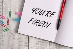 Conceptual hand writing showing You Re Fired. Business photo text Used by boss indicate employee that he is discharged royalty free stock photography