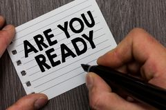 Conceptual hand writing showing Are You Ready. Business photo showcasing Alertness Preparedness Urgency Game Start Hurry Wide awak. E Man holding marker notebook royalty free stock photography