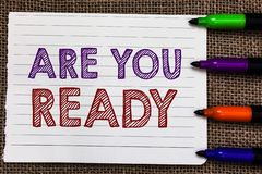 Conceptual hand writing showing Are You Ready. Business photo showcasing Alertness Preparedness Urgency Game Start Hurry Wide awak. E Notebook Paper Important royalty free stock image
