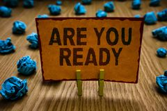 Conceptual hand writing showing Are You Ready. Business photo text Alertness Preparedness Urgency Game Start Hurry Wide. Awake Clothespins holding orange paper stock photos
