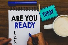 Conceptual hand writing showing Are You Ready. Business photo text Alertness Preparedness Urgency Game Start Hurry Wide. Awake Man holding marker notebook royalty free stock images