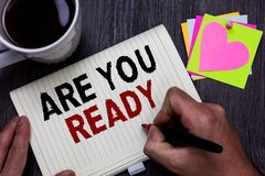 Conceptual hand writing showing Are You Ready. Business photo text Alertness Preparedness Urgency Game Start Hurry Wide awake Man. Holding marker giving ideas stock photos