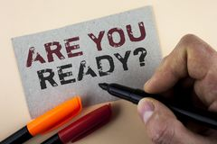 Conceptual hand writing showing Are You Ready Question. Business photo text Prepare well to face upcoming business changes written. By Man with Marker Cardboard Stock Photography